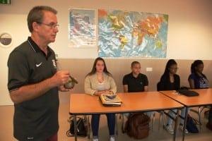 Bora teaches a group of high school students