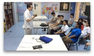 Cheen Tan teaches a group of teens in Singapore.